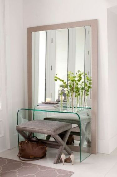 05-a-mirror-in-a-light-colored-wooden-frame-for-a-modern-entryway