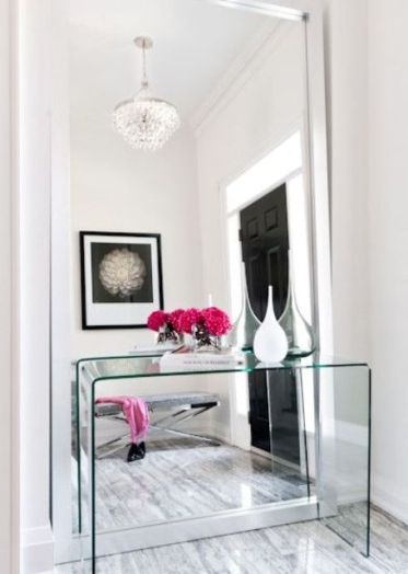 06-a-modern-mirror-with-no-frame-takes-the-whole-wall-and-a-glass-console-complements-the-look