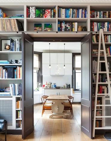 1-doorway-with-built-in-shelves-around-it-delineates-the-kitchen-and-the-doorway