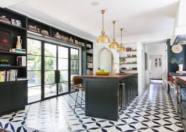 1-modern-industrial-style-kitchen-with-large-glass-doors-and-bookshelves-in-black-around-it