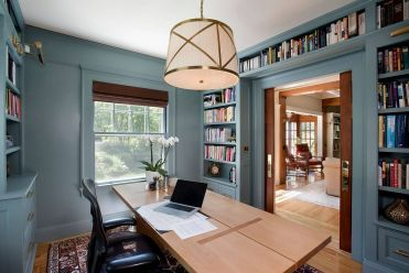 1-shelves-wrapped-around-the-doorway-are-a-smart-and-space-savvy-idea-in-the-modern-home-office