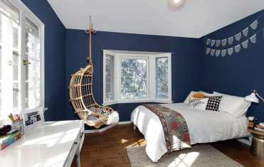 1-teenager-bedroom-with-hanging-rattan-chair-and-blue-walls