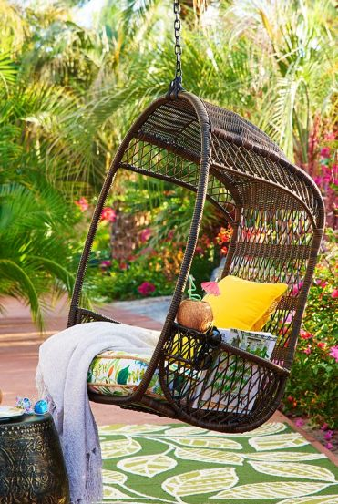 16-dark-swinging-hanging-chair-with-a-cushion-for-an-outdoor-space