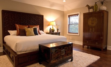 Asian-fusion-style-accentuated-by-the-ming-cabinet-at-the-foot-of-the-bed