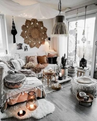 A-neutral-gypsy-space-with-macrame-boho-pillows-rugs-and-ottomans-a-fringe-lamp-and-boho-lamps