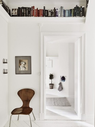 Above-door-book-storage-for-small-spaces