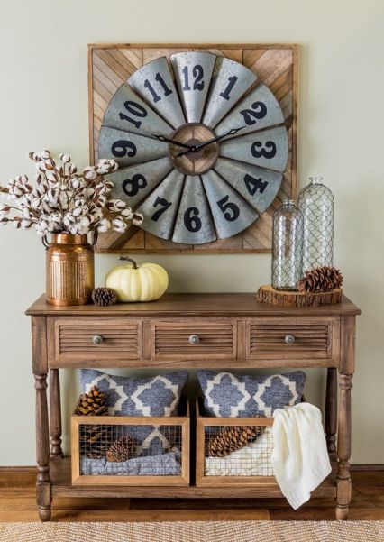 03-a-vintage-wooden-console-table-with-large-pinecones-cotton-branches-in-a-copper-vase-and-wooden-crates-with-pinecones