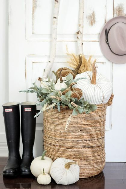 05-a-basket-with-fabric-pumpkins-of-various-colors-and-fresh-greenery-for-cozy-rustic-decor