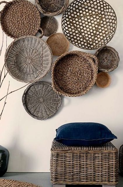 05-a-wicker-pouf-echoes-with-wall-baskets-and-creates-a-stylish-entryway