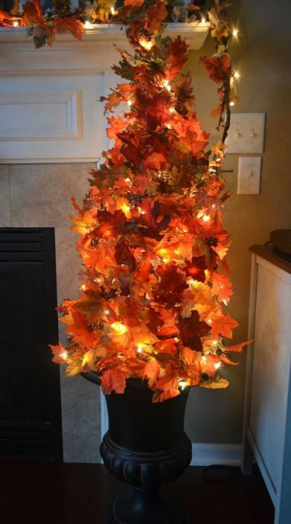 07-make-your-own-fall-topiary-tree-using-a-tomato-cage-fall-leaves-and-lights