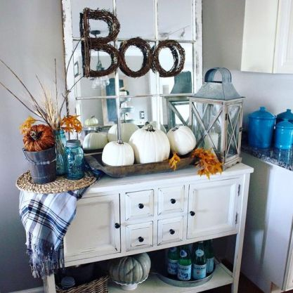 10-a-vintage-console-with-a-trio-of-white-pumpkins-fall-leaves-and-a-plaid-blanket
