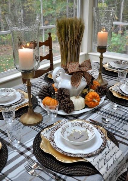 11-pinecones-tiny-pumpkins-and-wheat-for-a-centerpiece-black-woven-chargers-and-a-plaid-tablecloth-and-antique-candle-holders