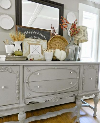 13-a-grey-farmhouse-console-table-with-faux-pumpkins-acorns-nuts-wheat-and-dried-flowers