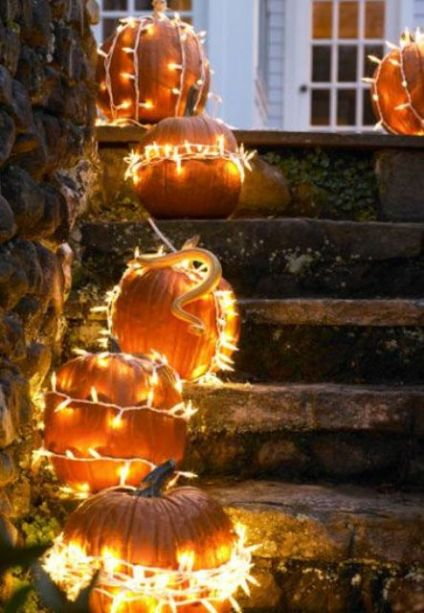 16-brighten-your-traditional-outdoor-decor-by-simply-wrapping-pumpkins-in-string-lights-1