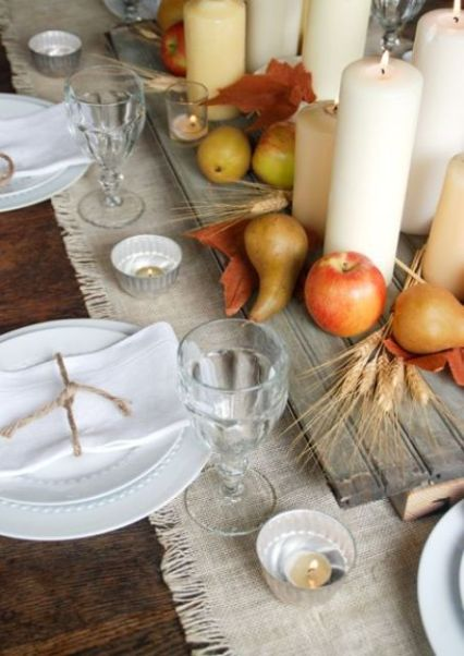 25-board-with-apples-pears-and-candles-on-a-fabric-table-runner