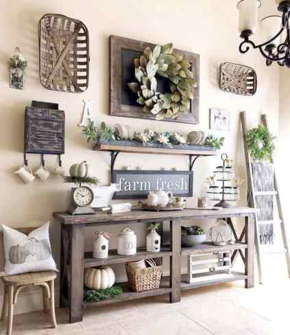 Diy-farmhouse-fall-decor-ideas-magnolia-wreath-pillows-pumpkins
