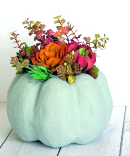 Faux-pumpkin-succullent-centerpiece-from-consumer-crafts-600x666-1