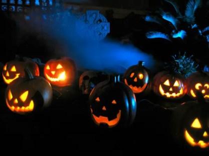 Orange-pumpkins-with-skull-cross-and-blue-background-lighting-600x450-1