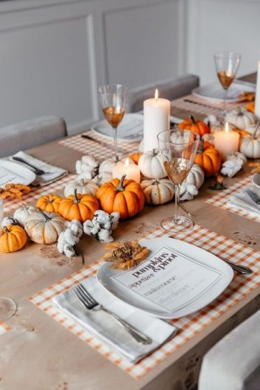 A-1-cozy-and-bright-fall-centerpiece-of-white-and-orange-pumpkins-pillar-candles-and-cotton