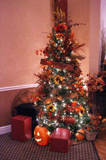 A-chic-thanksgiving-tree-with-lights-sunflowers-pumpkins-dried-grasses-and-leaves-plus-some-signs