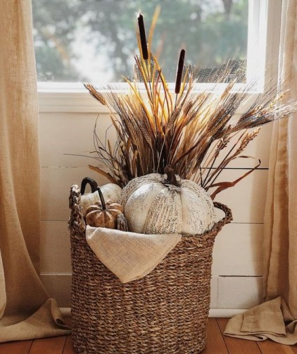 A-fall-basket-styled-with-faux-pumpkins-wheat-cane-and-burlap-is-a-cool-rustic-arrangement
