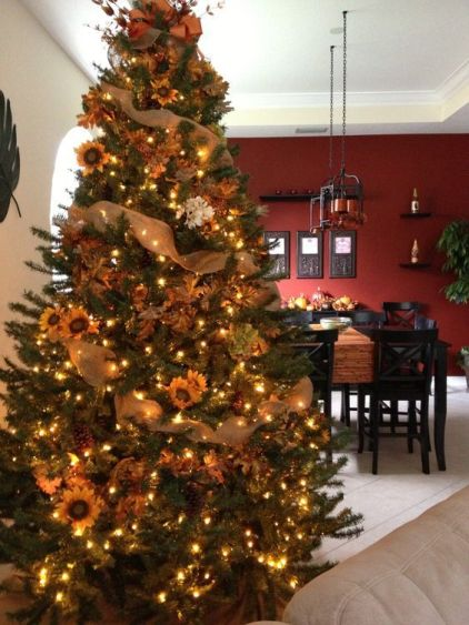 A-fall-tree-decorated-with-lights-leaves-sunflowers-burlap-ribbons-is-a-nice-rustic-decoration-for-thanksgiving
