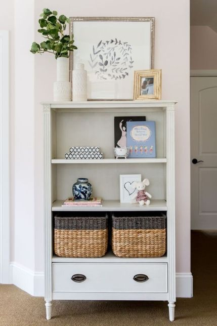 A-farmhouse-open-storage-unit-with-various-stuff-on-display-and-some-wicker-cubbies-for-smaller-stuff