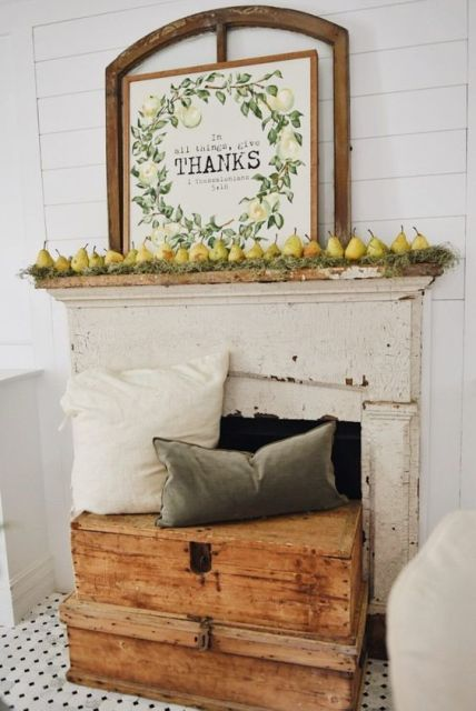 A-harvest-fall-mantel-with-moss-pears-and-a-cool-sign-plus-muted-pillows-on-wooden-boxes-1