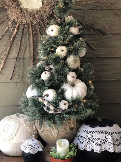 A-mini-fall-tree-with-white-pumpkins-lights-and-a-plaid-ribbon-is-a-stylish-decoration-for-fall-or-thanksgiving