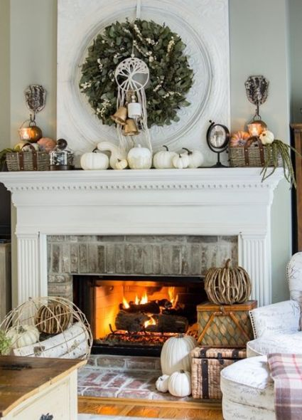 A-rustic-fall-mantel-with-white-pumpkins-baskets-with-faux-pumpkins-a-greenery-wreath-with-bells-and-vine-pumpkins