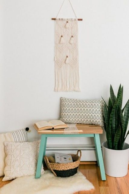 A-small-boho-entryway-with-a-tiny-bench-a-hack-by-ikea-boho-pillows-a-macrame-hanging-a-faux-fur-rug-and-a-basket-for-storage