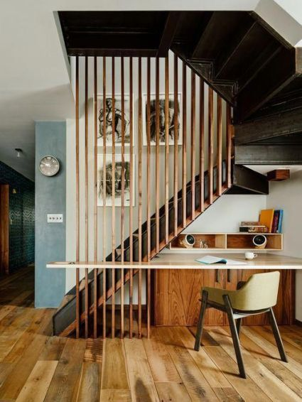 A-working-nook-under-the-stairs-with-sleek-storage-units-and-a-floating-desk-plus-a-chair