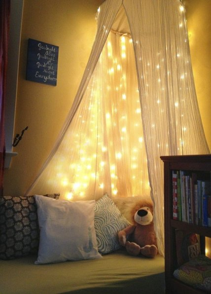 Cute-fairy-lights-decorated-kids-reading-nook