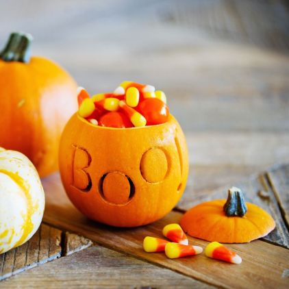 Trio-of-halloween-pumpkin-filled-with-candy-corn-royalty-free-image-1598995585
