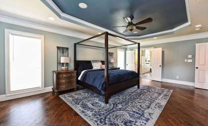 Two-color-blue-bedroom-with-white-trim-painted-tray-ceiling-and-wood-flooring
