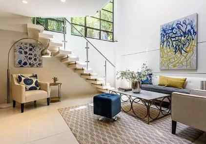 Under-stairs-seating-area-with-floor-lamp