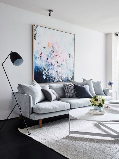 02-a-bold-oversized-artwork-over-the-sofa-is-a-cool-colorful-statement
