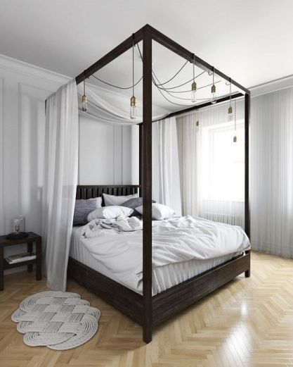 17-a-dark-stained-canopy-bed-with-light-fabric-and-lots-of-bulbs-hanging-on-it-for-additional-light-and-to-make-the-space-more-welcoming
