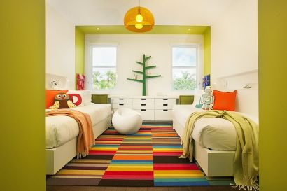 Bright-and-cheerful-kids-room-with-twin-beds-seems-super-fun-thanks-to-the-multi-colored-rug