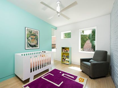 It-is-rug-in-bright-violet-that-anchors-this-scandinavian-nursery