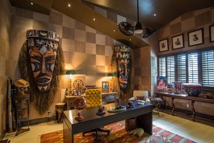 Large-masks-on-the-wall-for-an-exotic-and-audacious-home-office-design