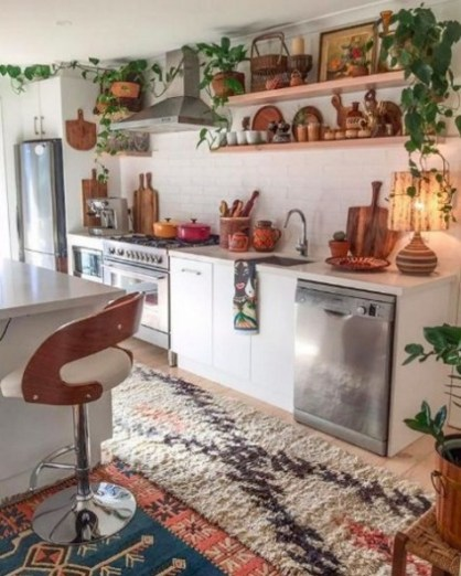 A-boho-space-with-boho-chic-rugs-potted-greenery-and-much-wood-and-plywood-in-decor