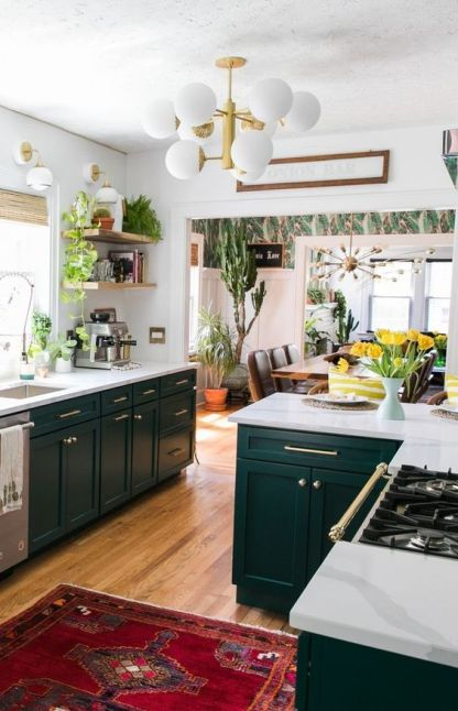 A-bright-boho-kitchen-with-a-colorful-boho-rug-potted-greenery-and-cacti-and-some-mid-century-modern-items