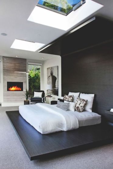 A-dark-stained-platform-continued-up-to-the-headboard-and-further-to-create-a-cozy-curled-up-look