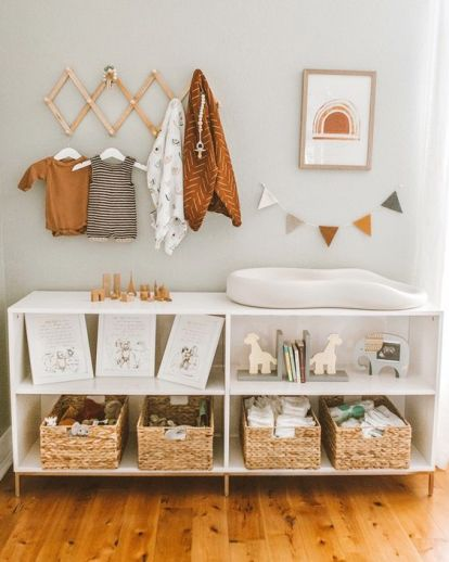 A-large-changing-table-with-woven-boxes-and-open-storage-compartments-for-toys-and-other-stuff