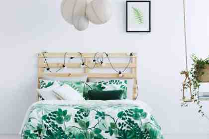 White-bedroom-with-wooden-bed-royalty-free-image-691782182-1547780421