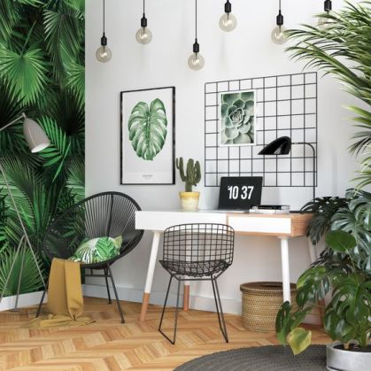 A-bright-tropical-home-office-with-a-tropical-leaf-wall-lots-of-potted-greenery-artworks-a-woven-basket-and-hanging-bulbs
