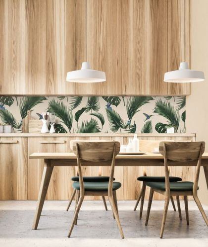 A-stylish-modern-kitchen-with-sleek-wooden-cabinets-a-tropical-leaf-backsplash-and-green-chairs-that-echo-with-it