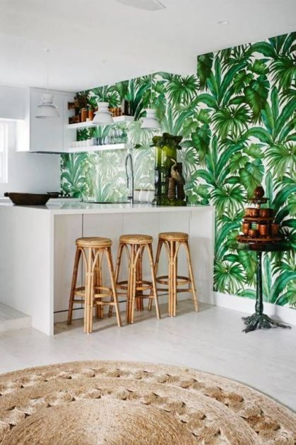 A-stylish-tropical-kitchen-with-a-tropical-leaf-wall-sleek-white-cabinets-rattan-stools-and-a-jute-rugs-reminds-of-beaches