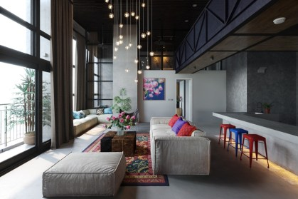 Flying-pendant-lights-colourful-stools-kitsch-living-room